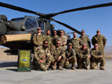 "Cigar Club members who are part of the PA Guard Aviation unit in Afghanistan. Front Row (L to R): OR6 Tim Totzke, SSG Mark Adams, CW2 Greg Anthony, MSGT Roger Kaley, and CW3 Jeff Braid. Back Row (L to R): Cpt Abe Phares, Spc Saul Grandenetti, CW2 Wyatt Saint, OR4 Igor Loncar, Cpt Steve McGouldrick, Cpt Bryan Donaldson, and CW2 Jeff Toy.  ""Smoking the cigars and good conversation made the deployment bearable and helped keep our sanity. Thanks for shipping us the cigars we ordered from you (there were MANY we ordered from you guys)."""