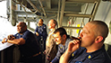 Members of the USS Nimitz as part of the (CSG-11) enjoying cigars.